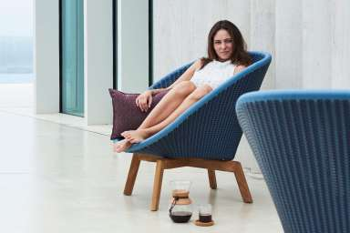 Peacock lounge chair blue Cane-line